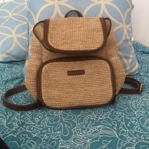 Brown woven backpack purse with leather details